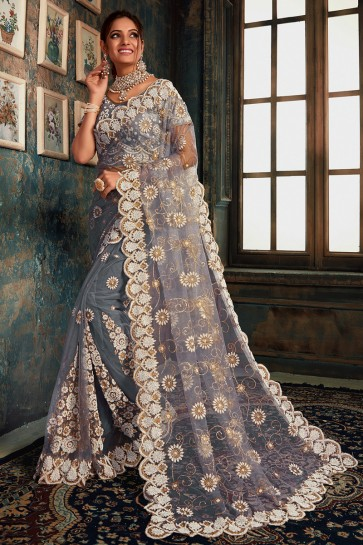 Optimum Zari Work And Stone Work Grey Net Fabric Designer Saree With Fancy Fabric Blouse