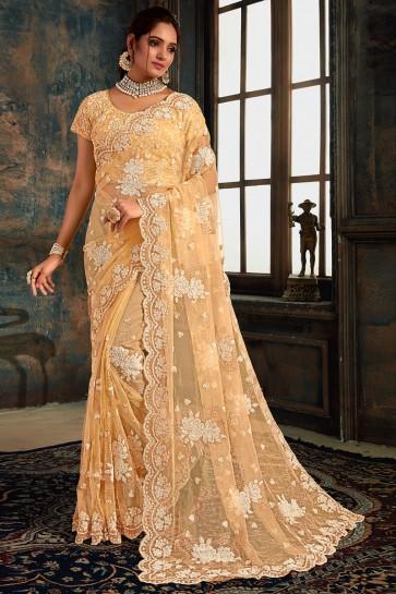 Net Fabric Cream Zari Work And Stone Work Designer Saree With Fancy Fabric Blouse