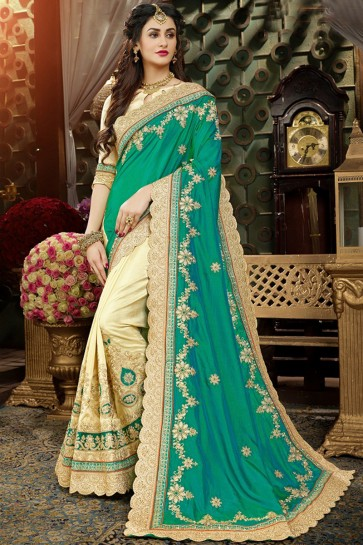 Charming Georgette Cream And Sea Green Embroidery Work Saree And Blouse