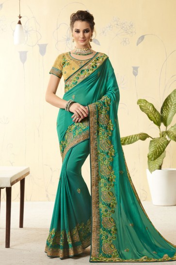Lovely Turquoise Georgette Embroidered Designer Saree With Jacquard Blouse