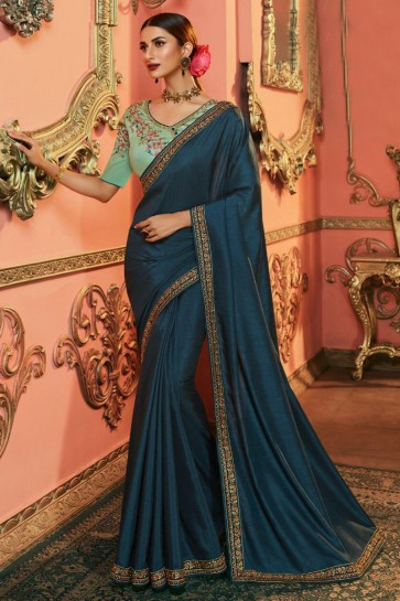 Ultimate Teal Embroidered Silk Saree And Blouse