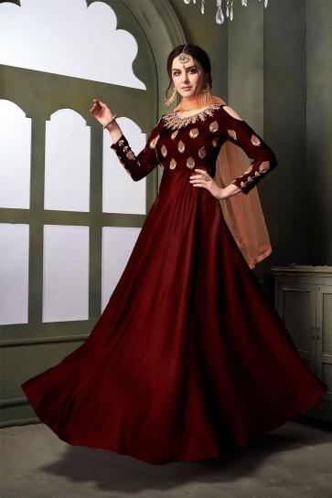 Desirable Maroon Satin and Silk Embroidered Designer Anarkali Salwar Suit With Net Dupatta