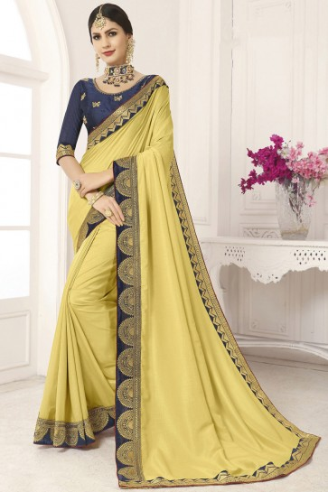 Classy Yellow Silk Lace Work And Border Work Saree And Blouse