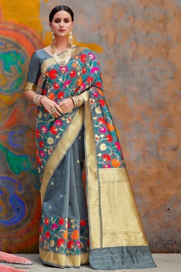 Pleasing Grey Weaving Work And Jacquard Work Silk Saree With Border Work Blouse