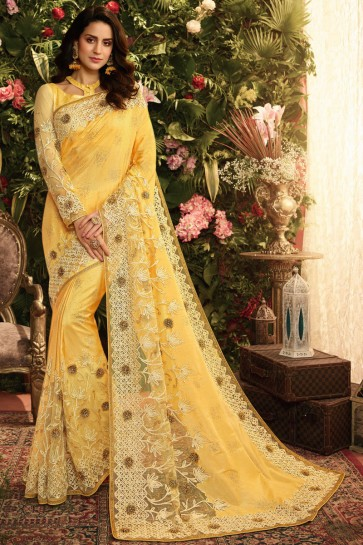 Pretty Embroidred And Stone Work Yellow Silk Saree With Border Work Blouse
