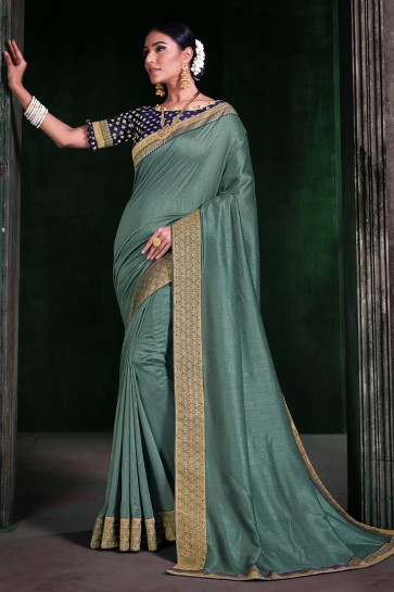 Border Work And Weaving Work Sea Green Silk Fabric Saree And Blouse