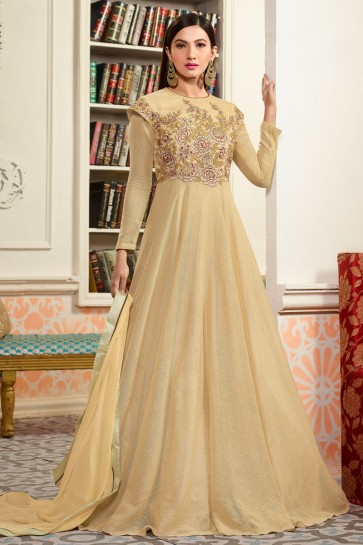 Gauhar Khan Desirable Cream Long Length Net Fabric Anarkali Salwar Suit