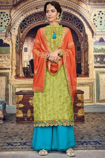Banarasi Silk And Jacquard Mehendi Green Embroidered Plazzo Suit With Jacquard Dupatta