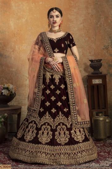 Maroon Embroidered And Zari Work Velvet Fabric Lehenga Choli With Net Dupatta