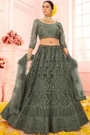Embroidery Stone Worked Net Fabric Designer Green Lehenga Choli With Net Dupatta