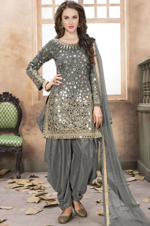 Embroidered Mirror Work Grey Net Fabric Patiala Suit With Net Dupatta
