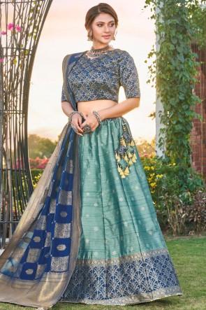 Designer Sky Blue Silk Fabric Weaving With Stone Work Lehenga Choli With Banarasi Silk Dupatta