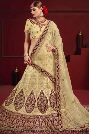 Stylish Maroon And Beige Thread Work And Stone Lehenga Choli With Net Dupatta