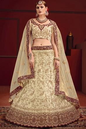 Gorgeous Beige And Maroon Thread And Zari Work Lehenga Choli With Net Dupatta