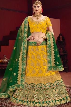 Beautiful Zari And Stone Work Yellow And Green Lehenga Choli With Net Dupatta