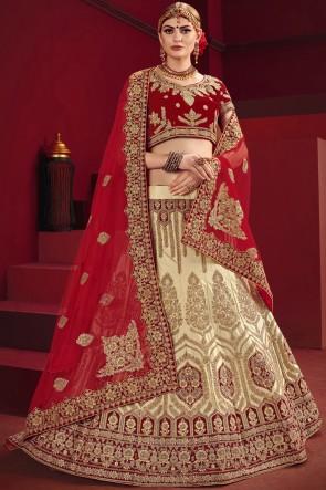 Beige And Red Thread Work And Stone Work Lehenga Choli And Satin Fabric