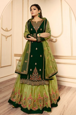 Drashti Dhami Delightful Green Embroidered And Lace Work Georgette Satin Lehenga Suit With Net Dupatta