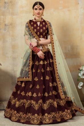 Sequins And Beads Work Coffee Silk Fabric Designer Lehenga Choli With Net Dupatta