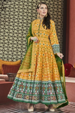 Printed And Hand Work Mustard Silk Fabric Abaya Style Anarkali Suit With Net Dupatta