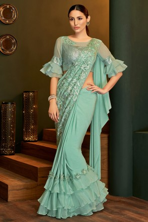 Lycra Fabric Sea Green Sequins Work And Embroidered Designer Flare Saree And Blouse