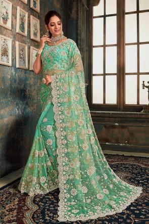 Sky Blue Net Fabric Zari Work And Stone Work Designer Saree With Fancy Fabric Blouse