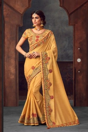 Cream Silk Fabric Stone Work and Embroidered Designer Saree And Blouse