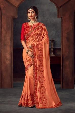 Optimum Stone Work and Embroidered Peach Silk Fabric Designer Saree And Blouse