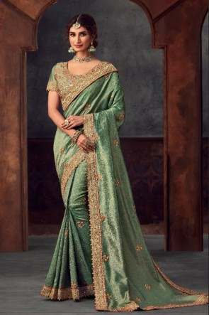 Stunning Green Silk Fabric Designer Stone Work and Embroidered Saree And Blouse