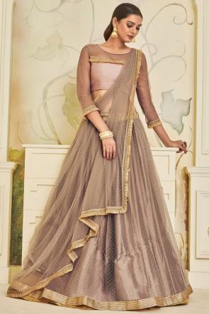 Dazzling Beige Lace Work And Beads work Net Designer Lehenga Choli And Dupatta