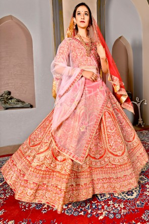 Graceful Silk Orange Embroidered Lehenga And Blouse With Net Dupatta