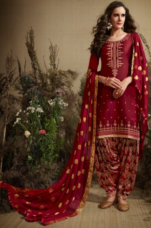 Pleasing Embroidered And Jacquard Work Maroon Silk Patiala Suit With Nazmin Dupatta