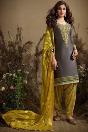 Party Wear Silk Jequard Bottom Fabric Grey Cotton Anarkali Suit With Nazmin Dupatta