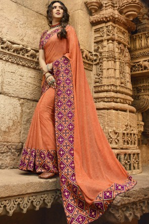 Desirable Peach Georgette Border Work And Printed Saree And Blouse