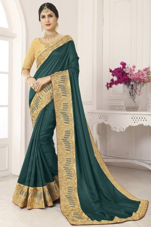 Lovely Teal Lace Work And Border Work Silk Saree And Blouse