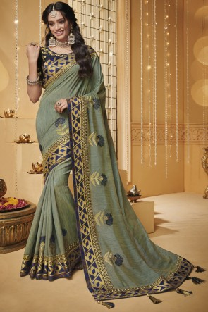 Appealing Pista Embroidered And Border Work Saree With Border Work Blouse