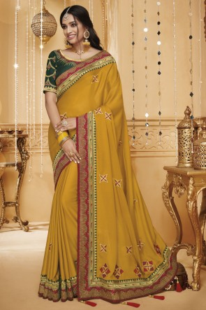Pretty Border Work And Embroidered Yellow Silk Saree With Border Work Blouse