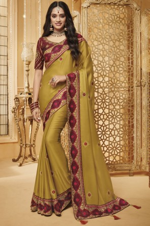Appealing Olive Border Work And Embroidered Silk Saree With Border Work Blouse