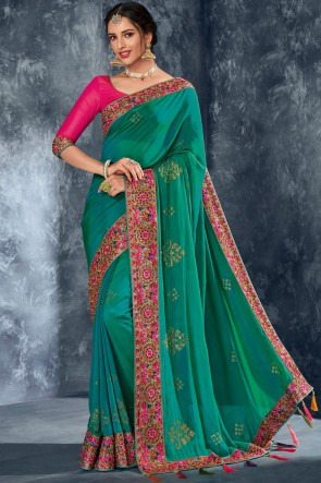 Charming Turquoise Silk Fabric Stone Work Designer Saree With Embroidered Blouse