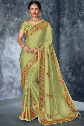 Stone Work And Embroidered Pista Silk Fabric Saree With Thread Blouse