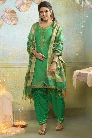 Party Wear Chanderi Fabric Green Embroidery Work Patiala Suit With Banarasi Silk Dupatta