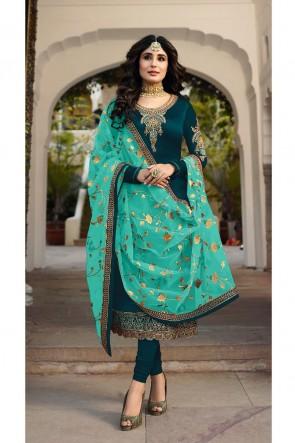 Kritika Kamra Lovely Embroidered And Stone Work Blue Georgette Satin Salwar Kameez With Net Dupatta