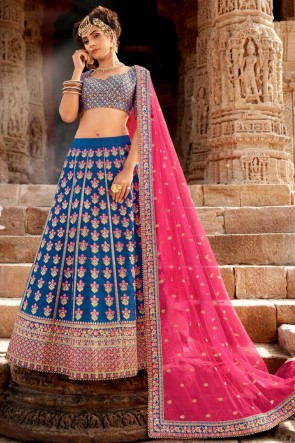 Silk Fabric Blue Embroidery And Stone Work Designer Lehenga Choli With Net Dupatta