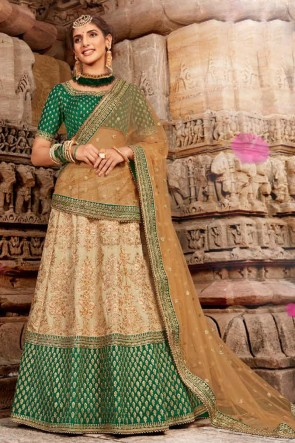 Embroidery And Stone Work Beige And Green Silk Fabric Lehenga Choli With Net Dupatta