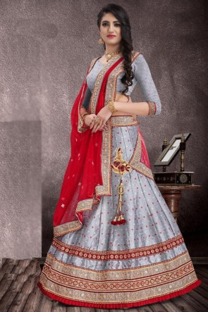 Silver Jacquard Bhandhani Weaving Work And Lace Work Lehenga Choli With Net Dupatta