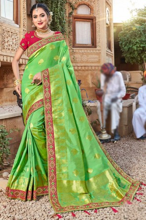 Gorgeous Light Green Stone Work And Weaving Work Weaving Silk Fabric Saree And Blouse