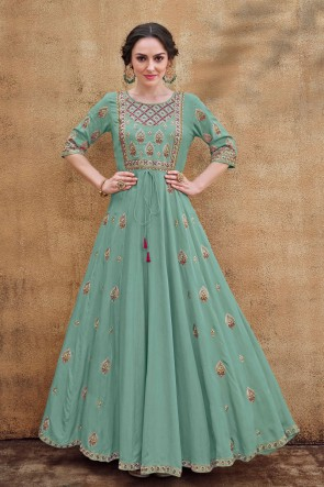 Fascinating Turquoise Embroidered Designer Rayon Fabric Gown