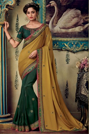 Heavy Designer Embroidery And Zari Work Mustard And Green Art Silk Fabric Saree And Blouse