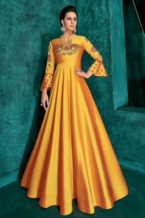 Delightful Yellow Embroidered Designer Silk Fabric Gown