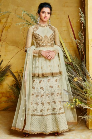 Beautiful Pista Embroidered Designer Net And Silk Anarkali Suit And Dupatta