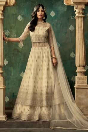 Cream Net Embroidered Abaya Style Lehenga Suit And Dupatta